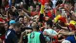 Eden Hazard celebrates victory with the Belgium fans