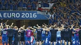 The Iceland players celebrate with their supporters at Stade de Nice