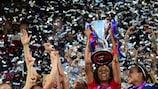 Lyon's Wendie Renard lifts the trophy