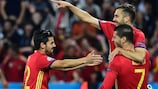 Álvaro Morata is mobbed after his second, Spain's third