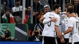 Germany celebrate during their 4-1 friendly win against Italy in March
