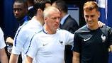 France coach Didier Deschamps (left) with striker Antoine Griezmann