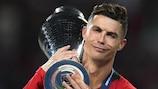 Cristiano Ronaldo cradles the UEFA Nations League trophy