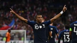 Kylian Mbappé celebrates his early goal against the Netherlands