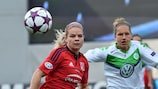 Eugénie Le Sommer (left) is in fine form for Lyon while Babett Peter scored a crucial goal for Wolfsburg this weekend