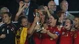 Birgit Prinz lifts the trophy in 2009; her and Germany's fifth success in a row