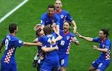 Luka Modrić is congratulated after scoring for Croatia
