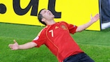 David Villa celebrates scoring his and Spain's second goal in the first match with Russia
