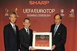 UEFA president Michel Platini (right) attended the signing ceremony with EUROTOP partner Sharp