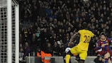 Having chipped the ball over Manuel Almunia, Lionel Messi lashes in