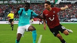 Standard's Bia Mujangi (left) competes with Mohammed Abdellaoue of Hannover