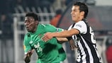 Rubin striker Obafemi Martins takes on PAOK's Diego Arias as both sides went through from Group A