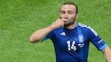 Dimitris Salpingidis celebrates scoring the equaliser in Warsaw