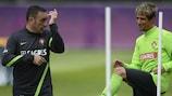 Paulo Bento (left) shares a joke with Fábio Coentrão during training on Wednesday
