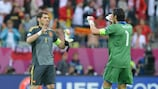 Gianluigi Buffon (R) of Italy and Spain's Iker Casillas at the end of the Group C meeting between the sides