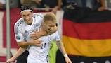 Marco Reus (right) and Mesut Özil enjoy a Germany goal against Greece