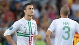 Cristiano Ronaldo (left) shows his disappointment after Portugal's shoot-out defeat