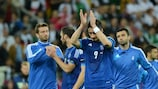 Nikos Liberopoulos leads Greece in applauding fans after the 4-2 loss to Germany