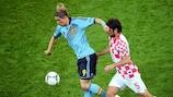 Croatia's Vedran Ćorluka vies with Fernando Torres of Spain