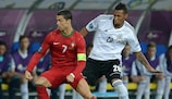 Cristiano Ronaldo is watched closely by Jérôme Boateng