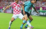 Spain's Álvaro Arbeloa shields the ball from Danijel Pranjić