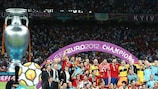 Spain celebrate after victory against Italy in the final