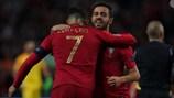 Bernardo Silva hugs Cristiano Ronaldo at full time