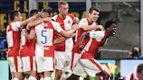 Peter Olayinka (right) after scoring for Slavia at Inter