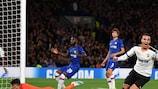Rodrigo (right) wheels away after scoring Valencia's winner at Chelsea