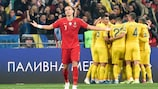 Portugal's defender Pepe reacts as Ukraine's players celebrate a goal during the Euro 2020 football qualification match between Ukraine and Portugal at the NSK Olimpiyskyi stadium in Kiev on October 14, 2019. (Photo by Genya SAVILOV / AFP) (Photo by GENYA SAVILOV/AFP via Getty Images)