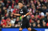 Hee Chan Hwang celebrates after scoring for Salzburg at Anfield
