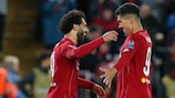 Liverpool's Mohamed Salah (left) celebrates with Roberto Firmino after scoring the Matchday 2 winner against Salzburg