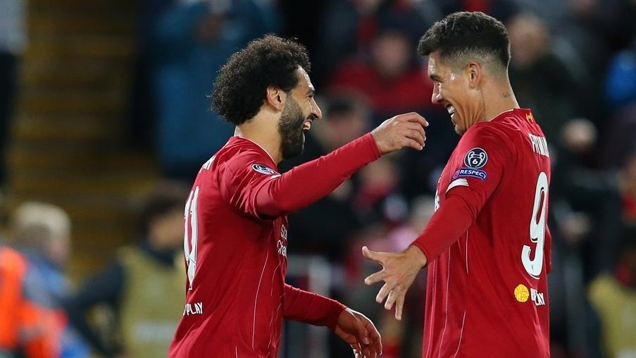 liverpool s mohamed salah left celebrates with roberto firmino after scoring the matchday 2 winner against salzburg.'