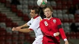 Elliott Hewitt in action for Wales Under-21s against Montenegro