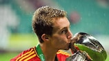 Gerard Deulofeu celebrates with the trophy after victory in the final against Greece