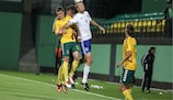 Finland goalscorer Tim Väyrynen (No9) jumps for the ball in Vilnius
