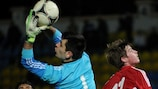 Armenia goalkeeper Arsen Beglaryan claims a cross in Minsk