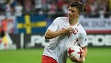 Late penalty against Sweden keeps Poland alive