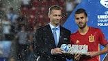 Spain's Dani Ceballos receives his Player of the Tournament award from UEFA President Aleksander Čeferin