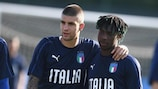 Italy's Gianluca Mancini and Moise Kean