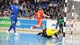 Serjão (left) looks on as Russia's Nikolai Pereverzev (No3) celebrates scoring against Azerbaijan