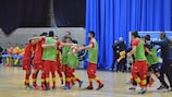 Montenegro celebrate beating Sweden to reach the main round