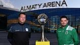 Jesús Velasco and Nuno Dias pose outside Almaty Arena with the trophy