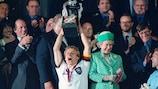 Germany's Jürgen Klinsmann lifts the trophy at EURO '96