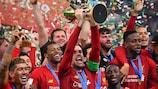 Liverpool captain Jordan Henderson lifts the FIFA Club World Cup
