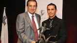 Roderick Briffa (right) receives the Maltese player of the year trophy from MFA president Norman Darmanin Demajo