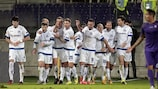 Dinamo Minsk celebrate after the opening goal from Sergei Kontsevoi (4th from left)
