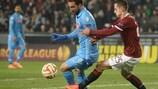 Napoli forward Gonzalo Higuaín shields the ball from Mario Holek