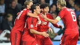 Son Heung-Min (second right) is congratulated after his winner for Leverkusen
