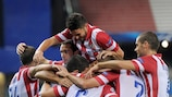 Miranda, buried beneath his team-mates, scored Atlético's first goal of the campaign
